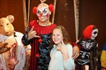 Clown from Haunted House Posses for picture with customer.