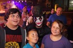 Joker Photo bombs family waiting in line